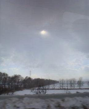 吹雪の中の太陽